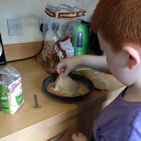Master Frugal making his big sister breakfast in bed.
