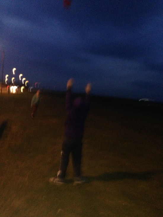 Playing frisbee at the beach in the dark.