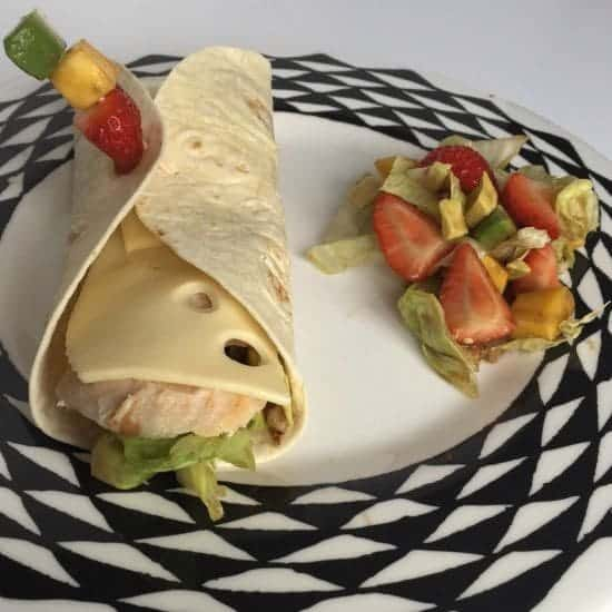 A Yummy chicken and cheese wrap with a sweet Summer salad.