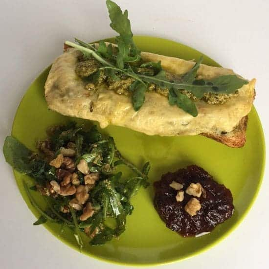 Gorgeous cheese and pesto toasted baguette with walnut and rocket salad