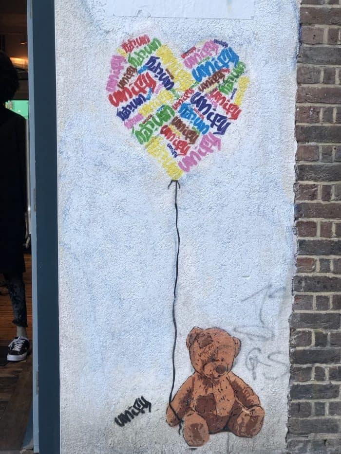 Admiring the street art in Shoreditch