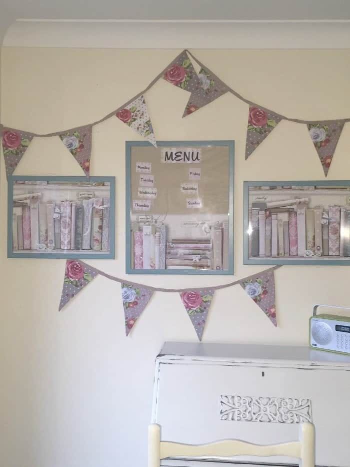 Pretty wall art and a menu planner made using free wallpaper samples and cheap ikea frames!