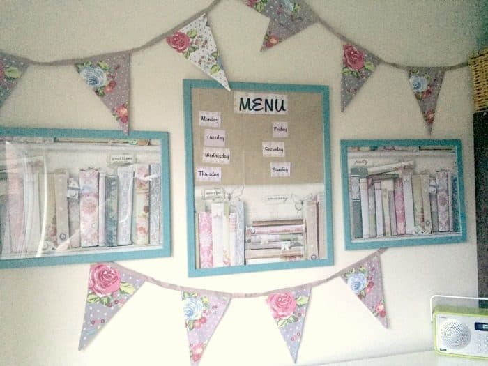Pretty wall art and a menu planner made using free wallpaper samples and cheap ikea frames....