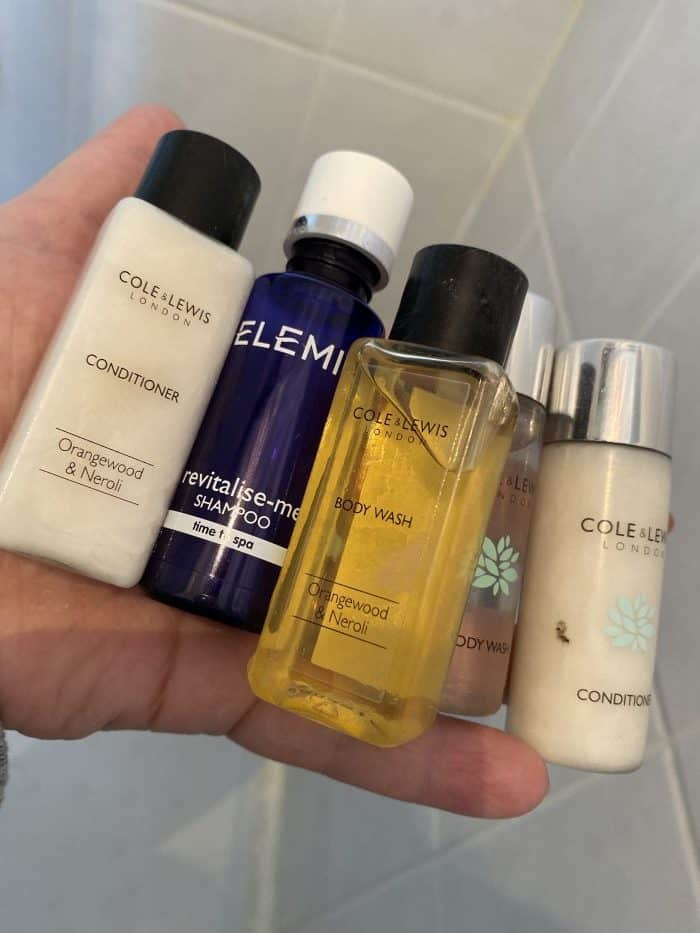 Using up hotel toiletries.