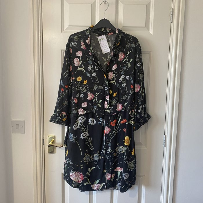 Warehouse dress with flowers on it