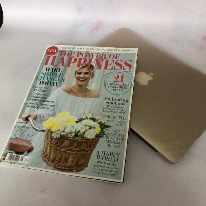 Macbook and magazine