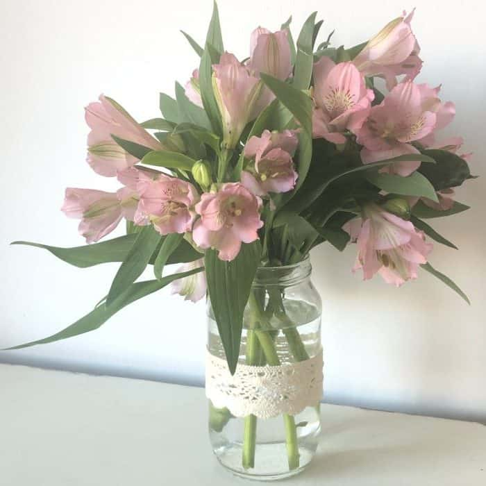 Homemade vase with bargain flowers